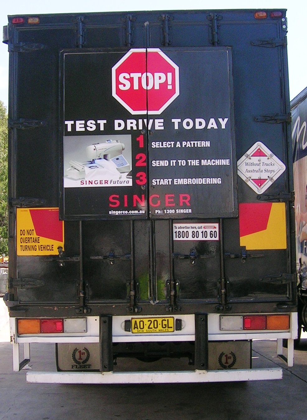 Truck advertising. TruckBack. Singer Sewing Machines. Test Drive Today campaigns. First Fleet Rigid. Small frame.