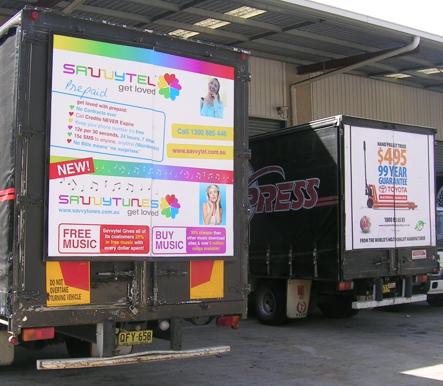 Truck advertising. TMHA Toyota Material Handling Australia TruckBack on First Fleet rigid. Frame. Hand pallet truck campaign. Savvytel Music campaign. Frame. First Fleet rigid.