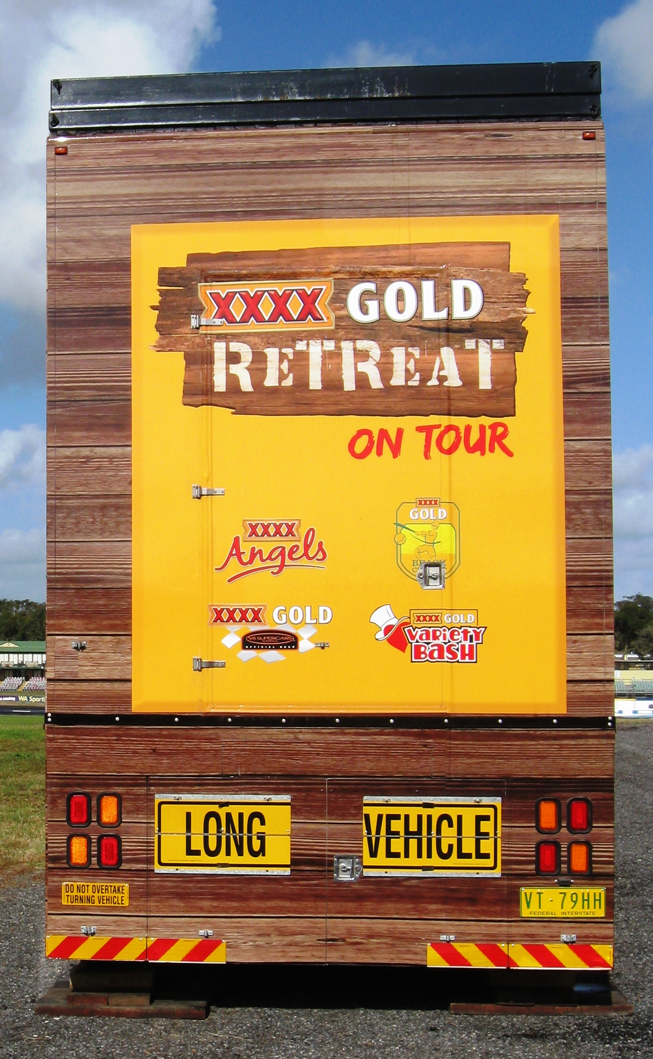 The world-famous XXXX Gold Retreat. Truck advertising. Vehicle-based events. Custom build. Fleet graphics. Truckside advertising. Vehicle Wraps. Trailer wraps. XXXX Angels. V8 Supercars. Lion Nathan. XXXX Gold. Full TrackBack. Long Vehicle.