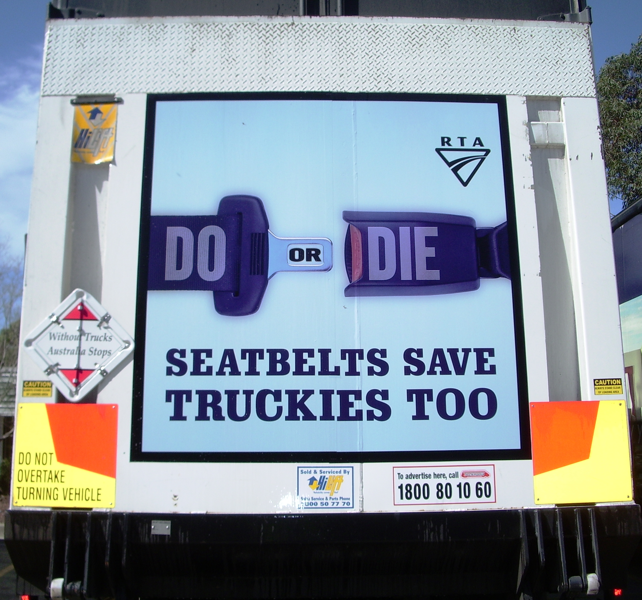 Truck advertising. RTA TruckBack Seatbelts Save Truckies Too RMS TfNSW. Tailgate.