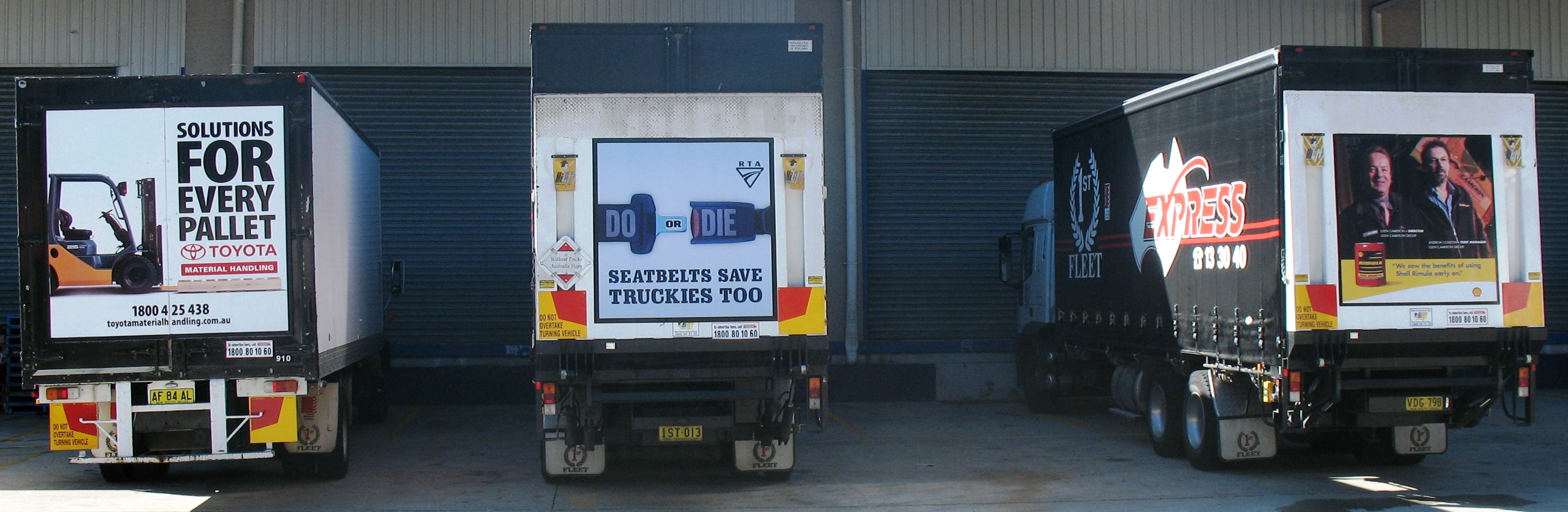 Truck advertising. TruckBacks. TMHA (Toyota Material Handling Australia) 8 series Solutions For Every Pallet campaign. Framed. Shell Rimula campaign x 2. Both flatbacks. All on First Fleet B-Doubles. RTA TruckBack Seatbelts Save Truckies Too RMS TfNSW. Tailgate.