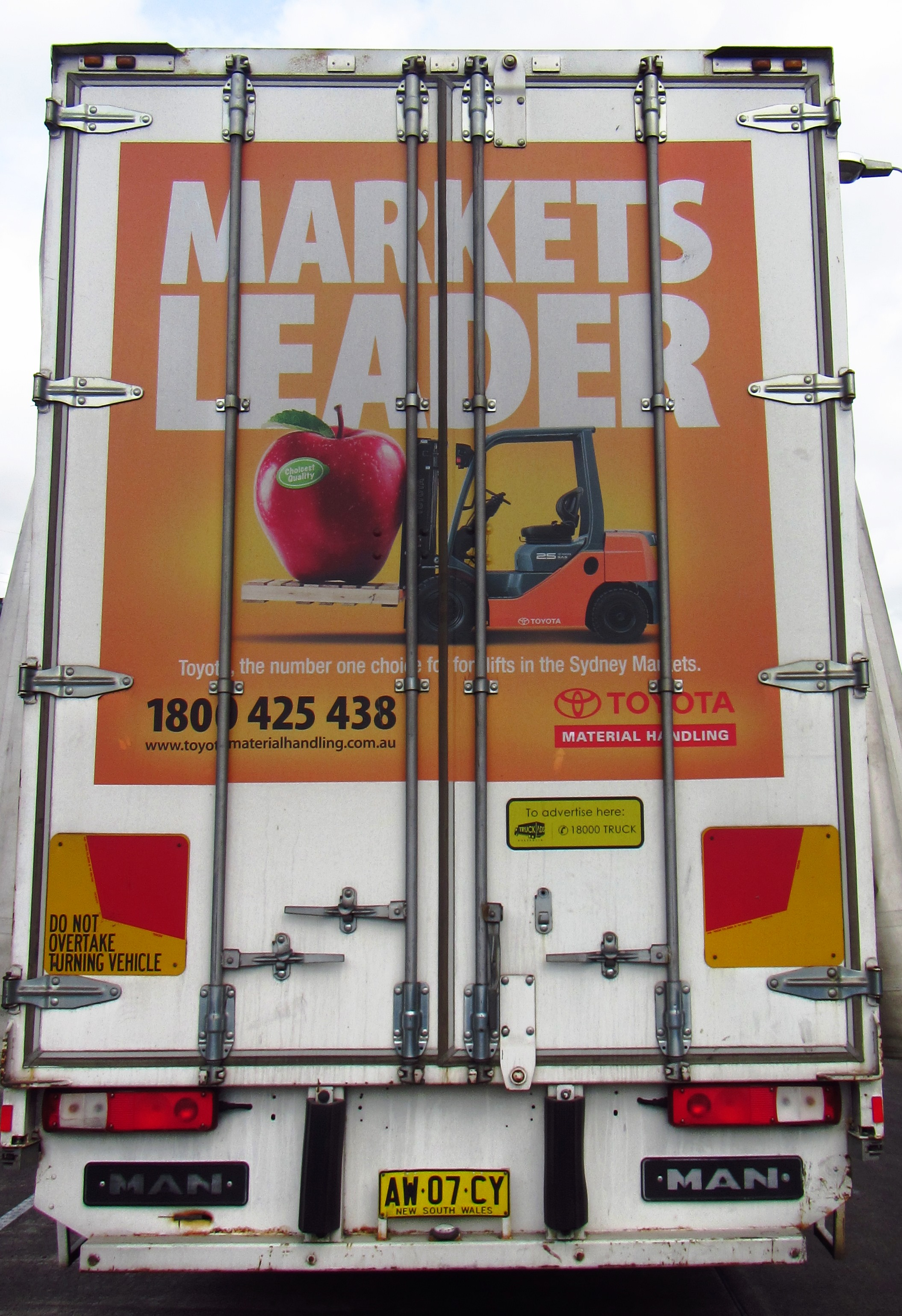 Truck advertising. TMHA Toyota Material Handling Australia TruckBack on SX rigid. Straight application. Markets Leader campaign. Tautliner. Flemington markets.