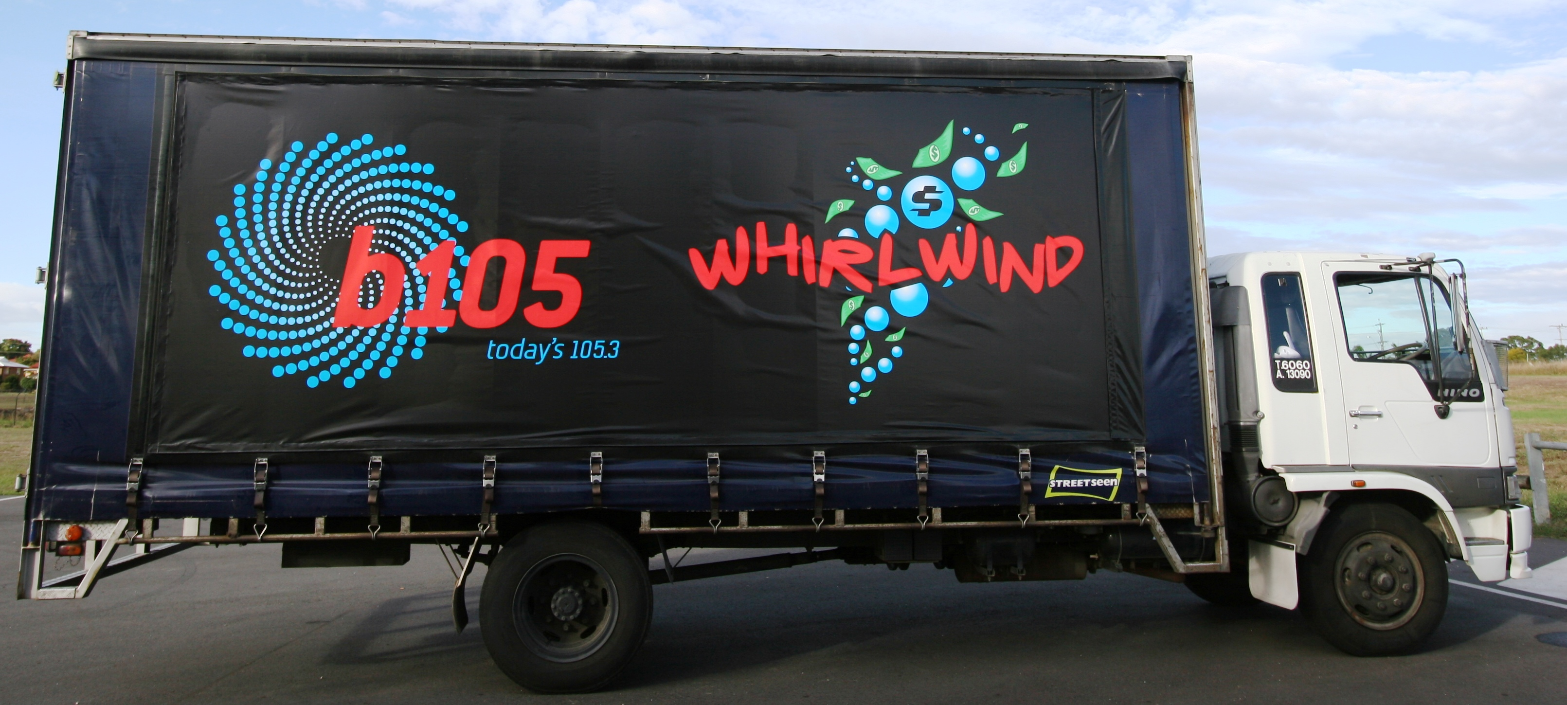 Truck advertising. B105 Whirlwind rigid tautliner. Brisbane. TruckSide. StreetSeen curtains. Austereo.