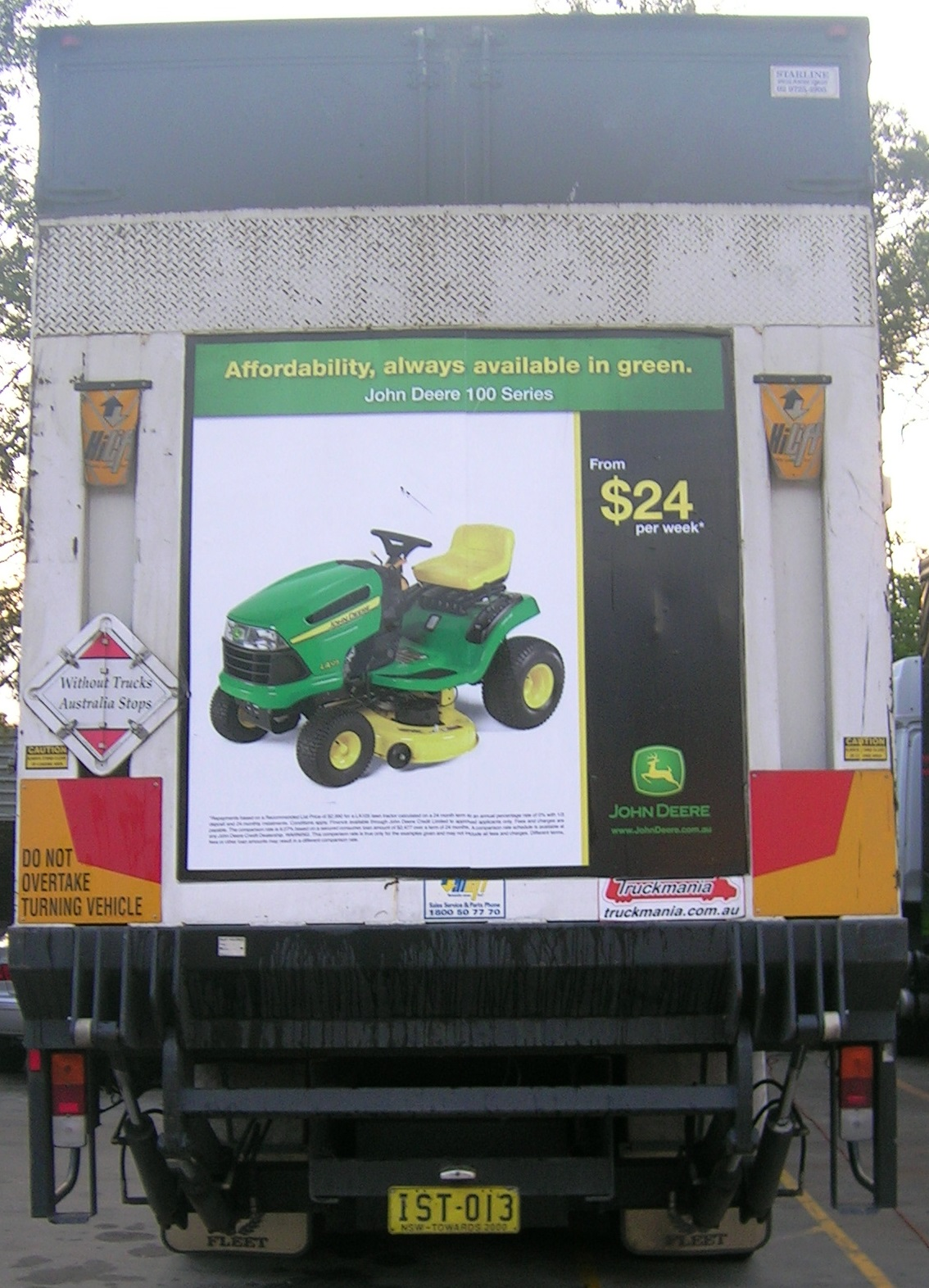 Truck advertising. TruckBack for John Deere 100 Series mowers. Affordability, always available in green campaign. On First Fleet vehicle. Tailgate.