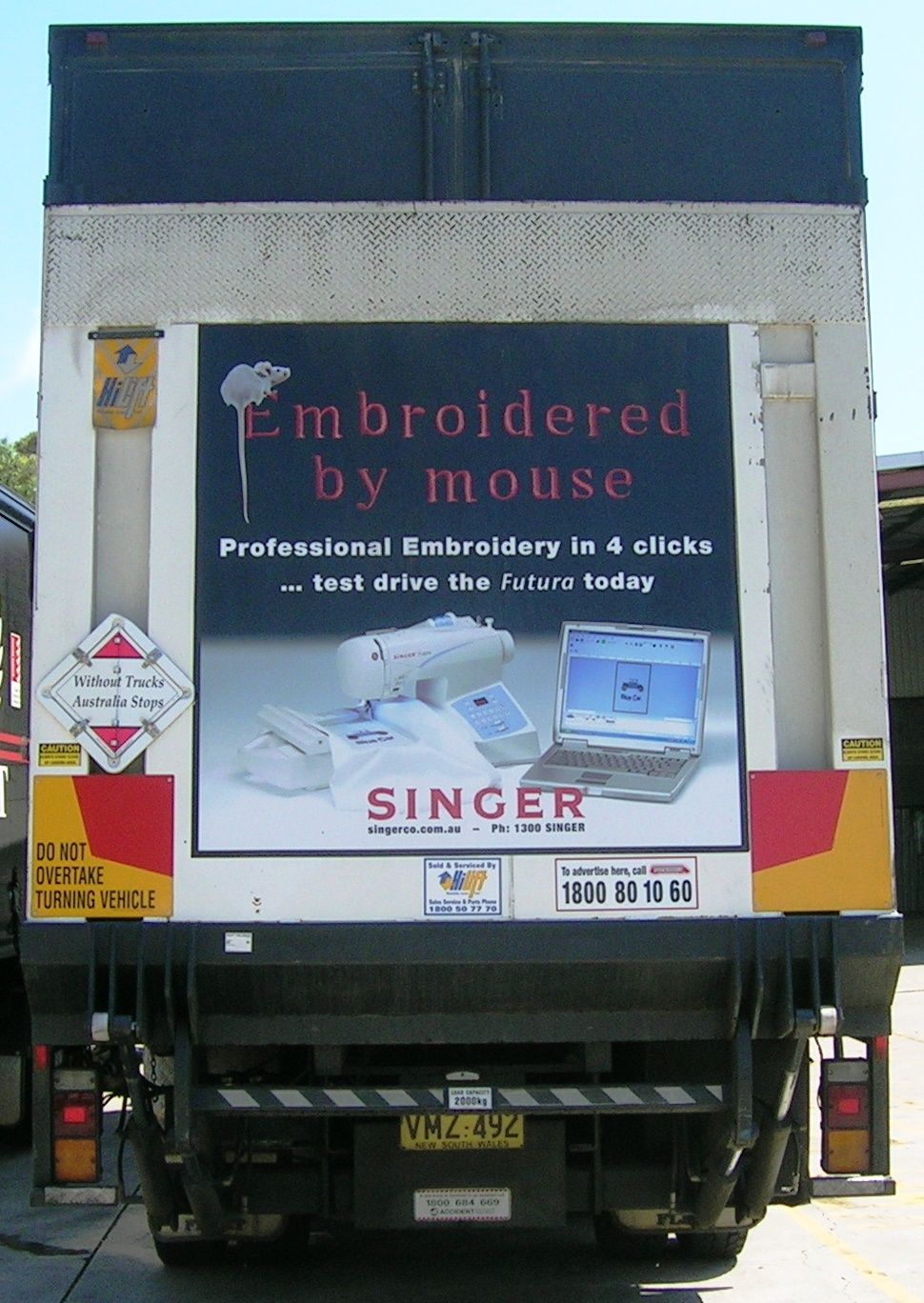 Truck advertising. TruckBack. Singer Sewing Machines. Embroidered by mouse campaign. First Fleet Rigid. Tailgate.