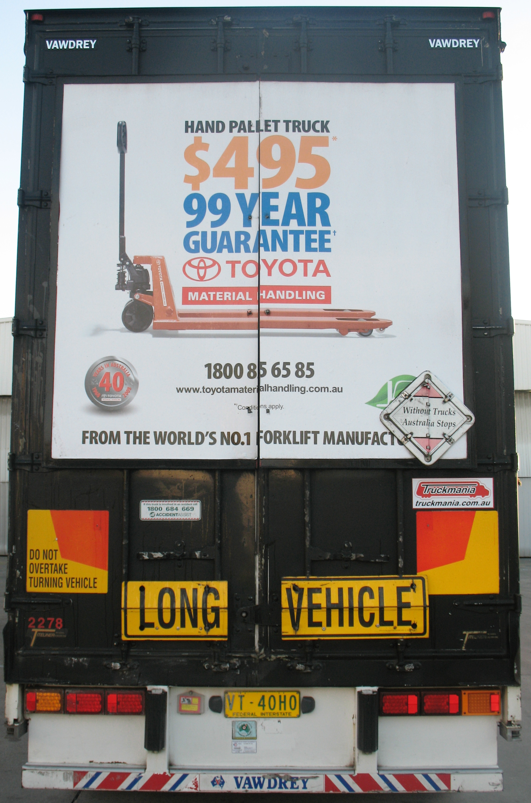 Truck advertising. TMHA Toyota Material Handling Australia TruckBack on First Fleet B Double Long Vehicle. Frame. Hand pallet truck campaign. Vawdrey.