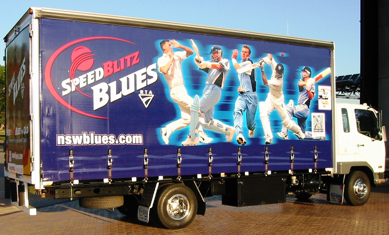 Truck advertising. NSW Speedblitz Blues TruckWrap at Sydney Olympic Park 2002. Cricket.