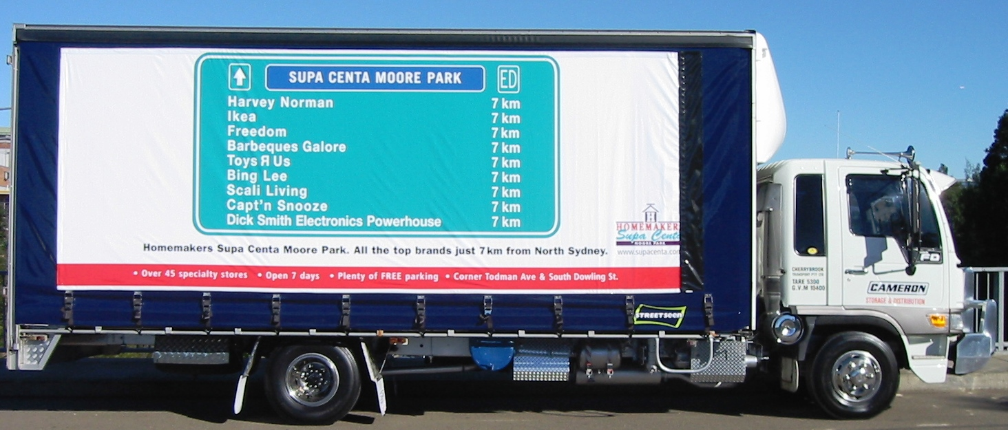 Truck advertising. Moore Park Supa Centa TruckWrap at Artarmon. TruckSide, Rigid, Tautliner, Cameron Transport, StreetSeen curtains