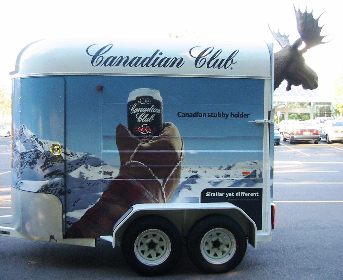 Vehicle-based events. Custom build. Fleet graphics. Canadian Club (CC) moose trailer - Similar yet different. Moose's head mounted on the rear.