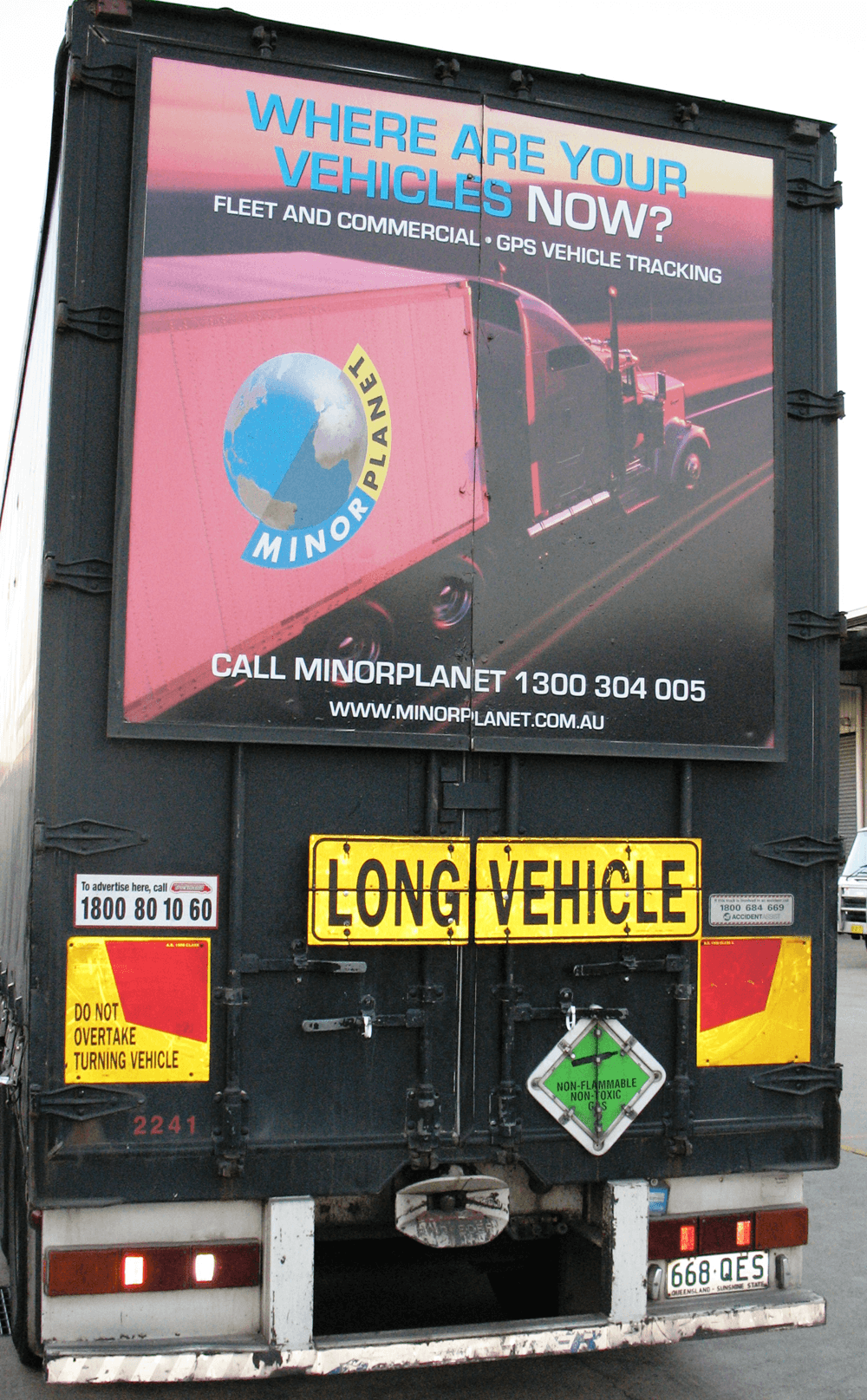 Truck advertising. Minorplanet TruckBack with frame on First Fleet B Double with Long Vehicle sign