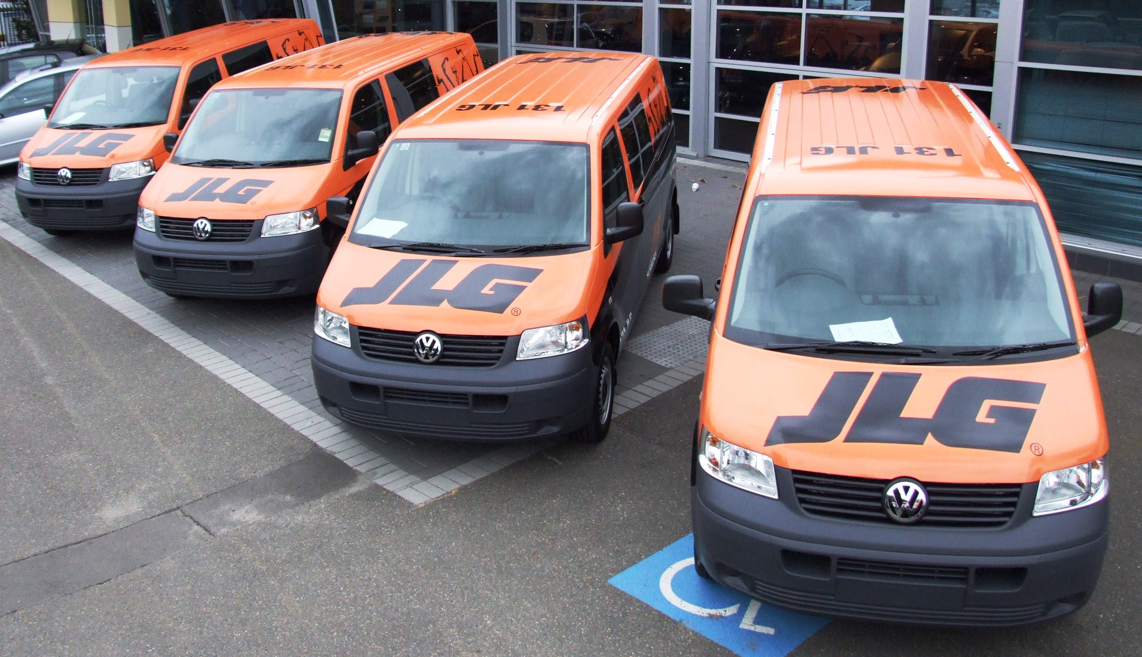 Fleet graphics. Vehicle graphics. JLG VW service vans. Four in a row.