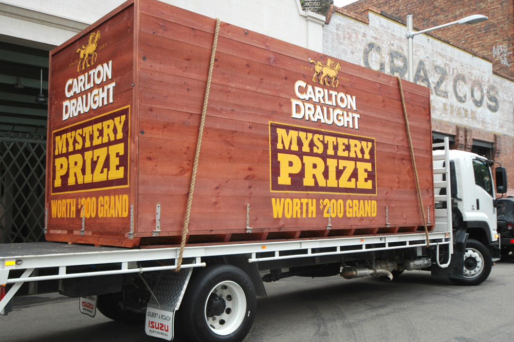Vehicle-based events. Custom build. Fleet graphics. Carlton Draught Mystery Prize Carlton Crate. Isuzu flat bed rigid. Walsh Bay. Tabletop.