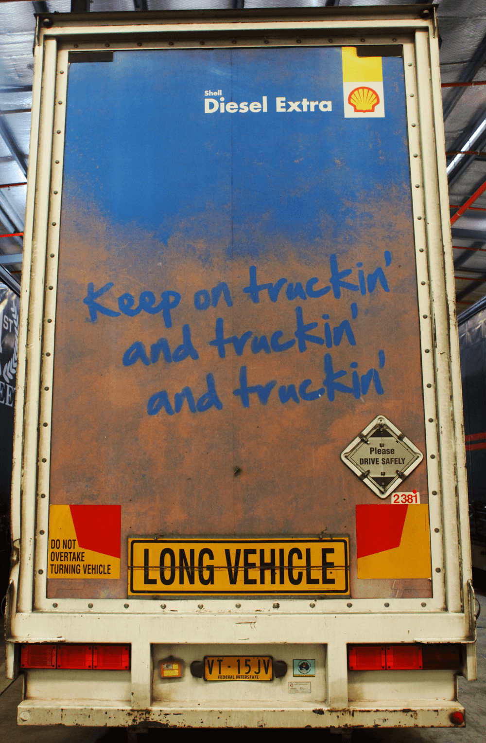 Truck advertising. Shell Diesel Extra custom TruckBack on First Fleet B Double with Long Vehicle sign.
