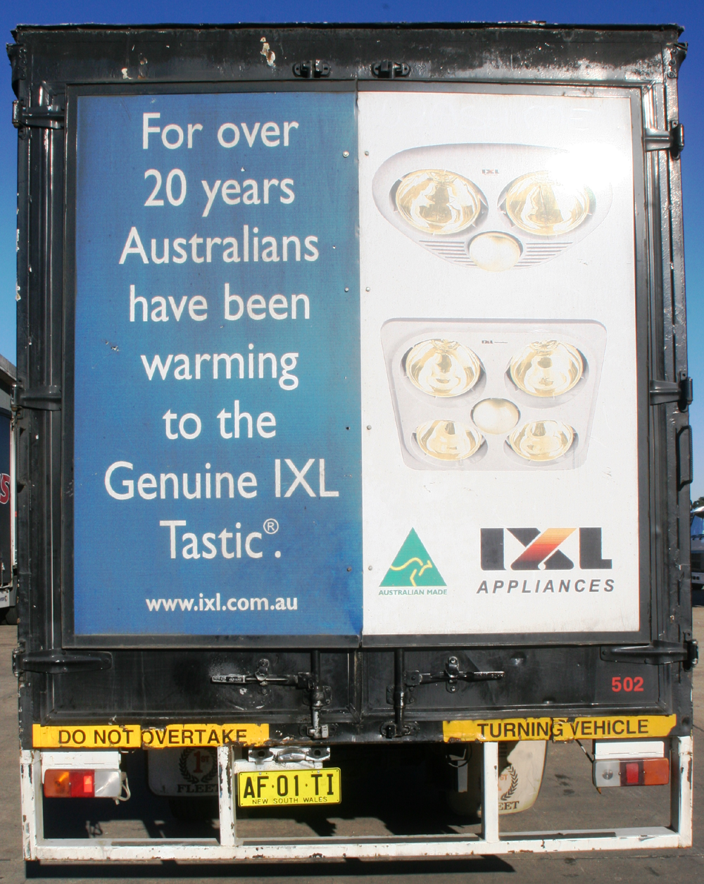 Truck advertising. IXL Appliances TruckBack with frame on First Fleet rigid.