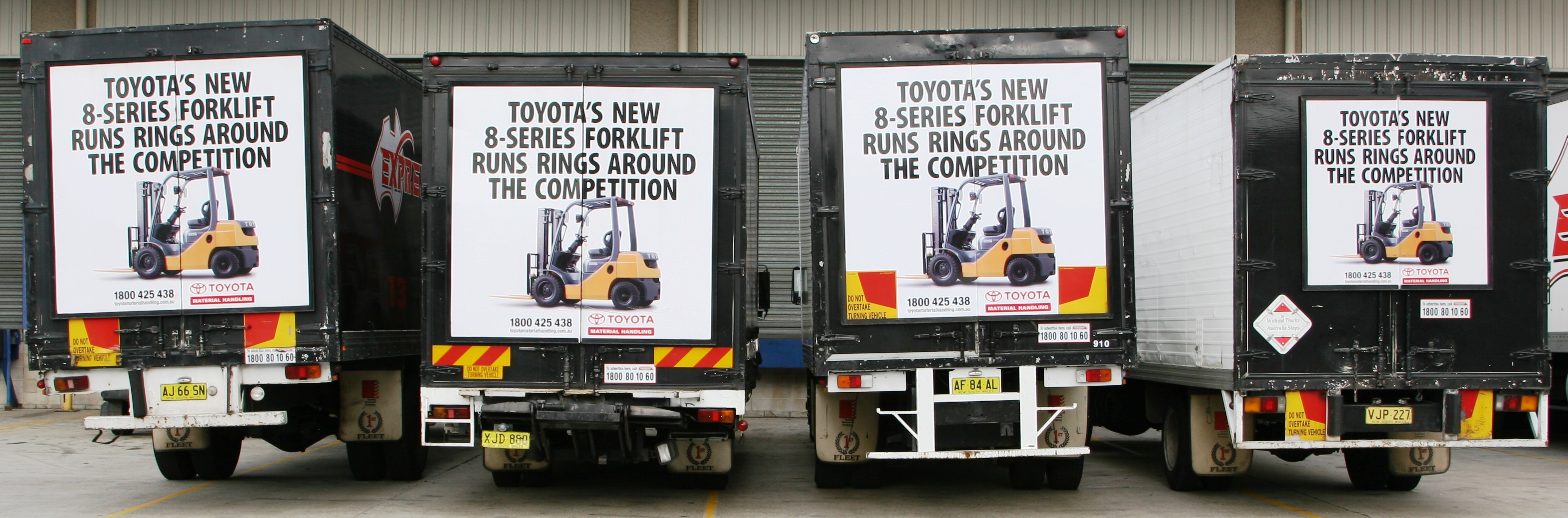 Truck advertising. Four of a kind - TruckBacks lined up for TMHA (Toyota Material Handling Australia) all on First Fleet vehicles. Toyota 8 series forklift.