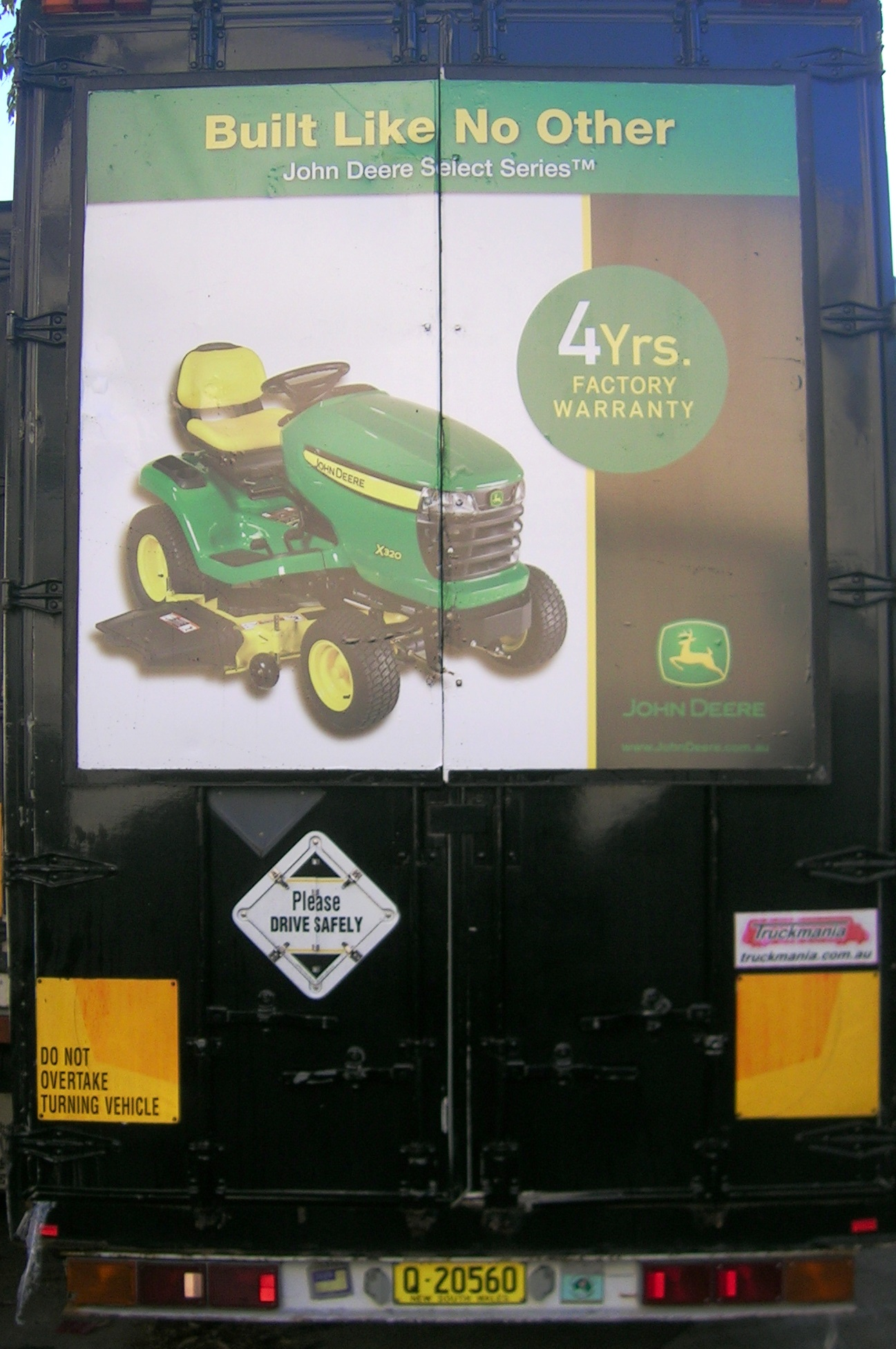 Truck advertising. TruckBack for John Deere Select Series mowers. On First Fleet vehicle. Frames.
