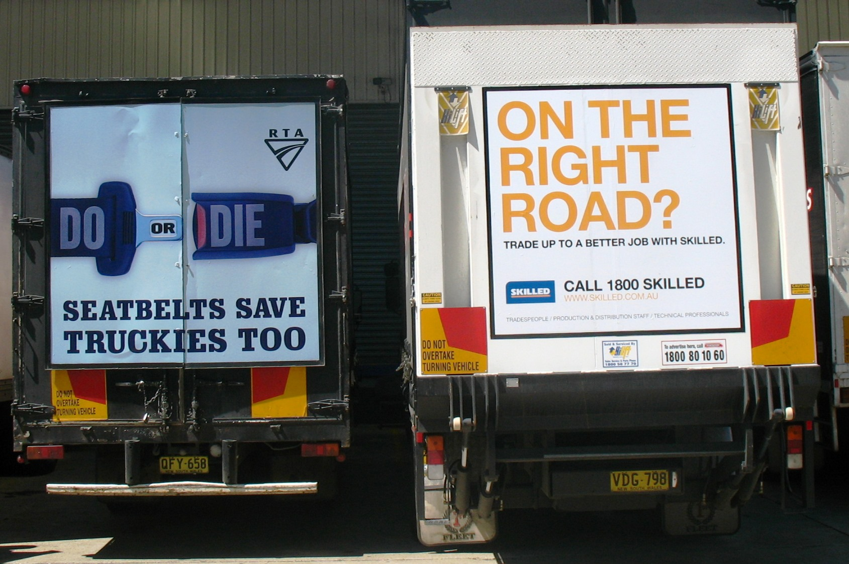Truck advertising. Two TruckBacks one for RTA/RMS/TfNSW Seatbelts Save Truckies Too and another for Skilled On The Right Road. On First Fleet rigid vehicles. One with frame, one with taillift.