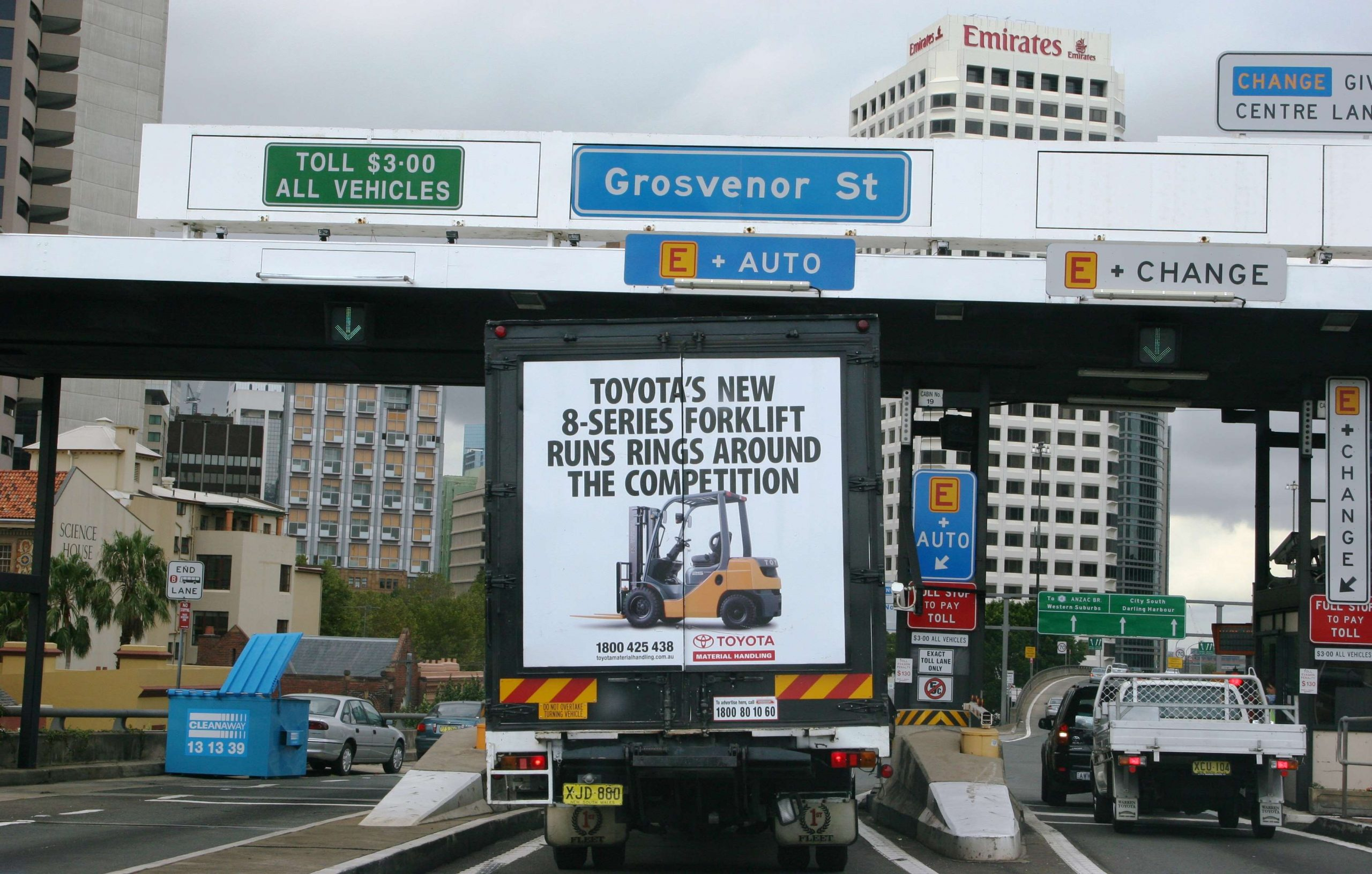 Truck advertising. TMHA Toyota Material Handling Australia TruckBack on First Fleet rigid. Frame. 8 series forklift Runs Rings Around the Competition campaign. Sydney Harbour Bridge at southern tollgates southbound.